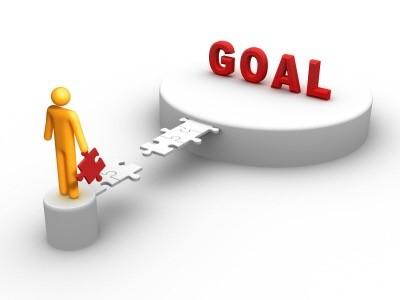 reach your goals puzzle piece