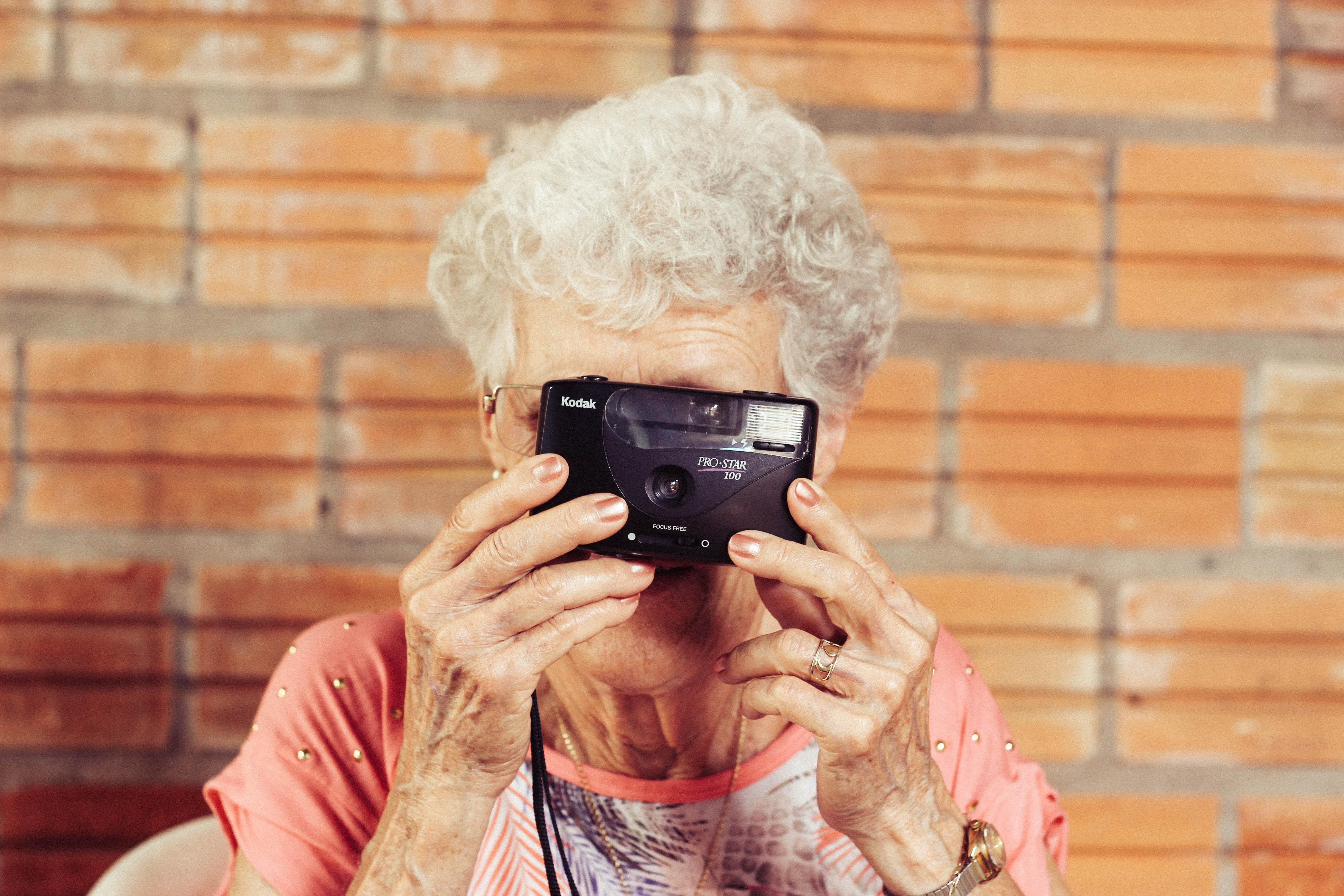 senior woman takes photo for facebook